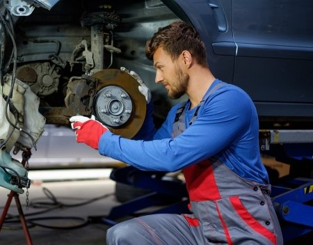 Mechanic reparing the brake problem