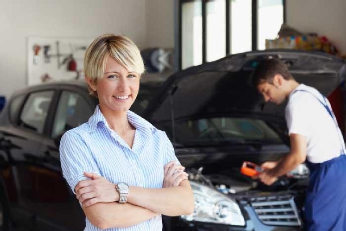 female employee standing near the car