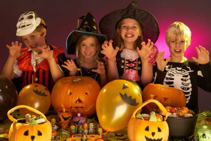 Halloween party with children wearing fancy dress costumes