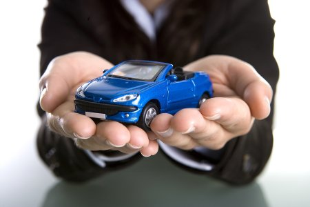 A man holding toy car