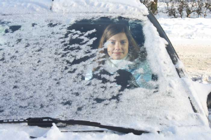 woman driving car in winter