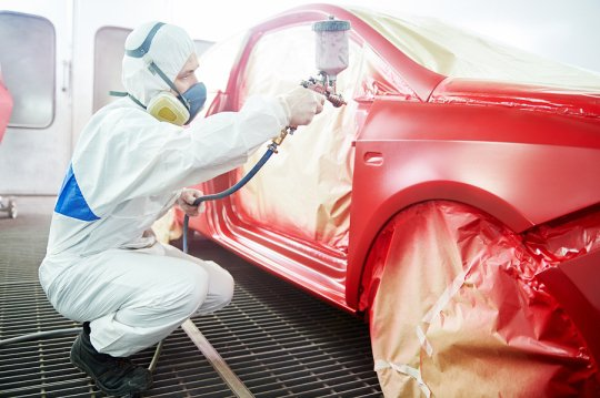 Man painting a car