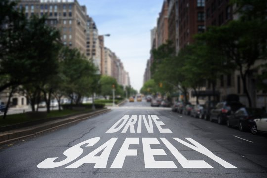 An image of a road with drive safely written on it