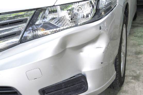 An image of a dented car