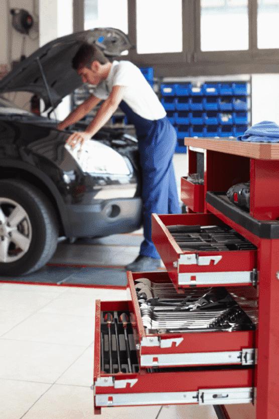 A car mechanic repairing a car